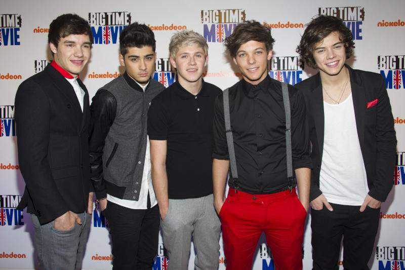 """FILE - In this March 8, 2012 file photo, members of the band One Direction, from left, Liam Payne, Zayn Malik, Niall Horan, Louis Tomlinson and Harry Styles attend the premiere of the Nickelodeon TV movie """"Big Time Movie"""" in New York. One Direction, who came in third place on the UK's """"X Factor"""" in 2010, is one of many boy bands who have recently emerged on the music scene since *NSYNC and Backstreet Boys dominated pop music in the 1990s. (AP Photo/Charles Sykes, file)"""