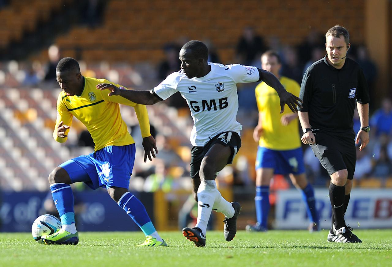Coventry City's Franck Moussa (left) holds off Port Vale's Anthony Griffith (right) during the Sky Bet League One match at Vale Park, Stoke.