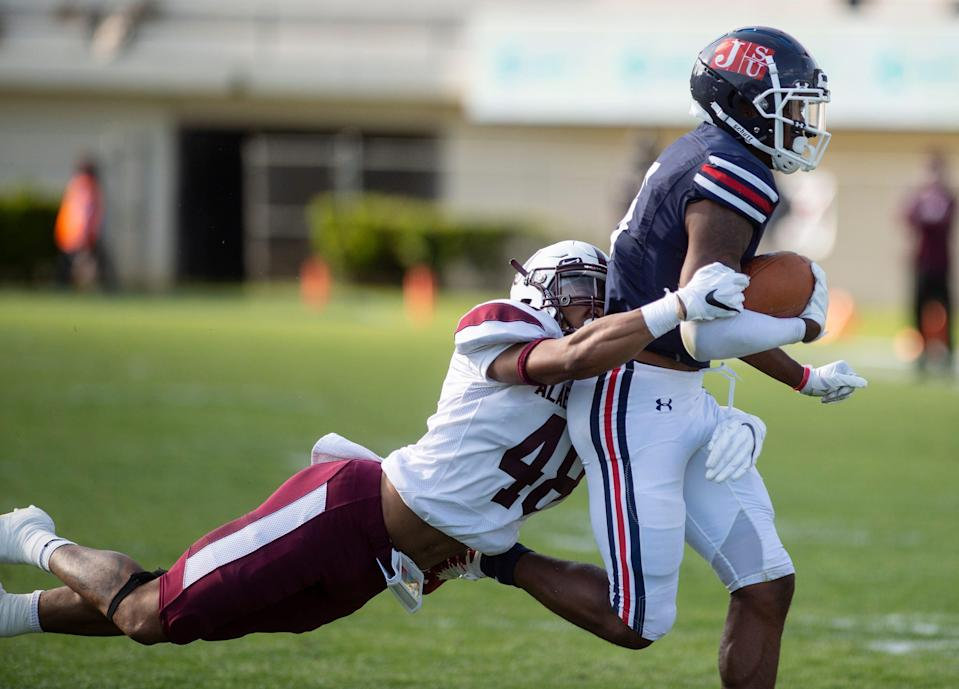 Jackson State University's Daylen Baldwin is stopped by Alabama A&M's JaBraun McNeal during their game at Veterans Memorial Stadium in Jackson, Miss., Saturday, April 10, 2021.