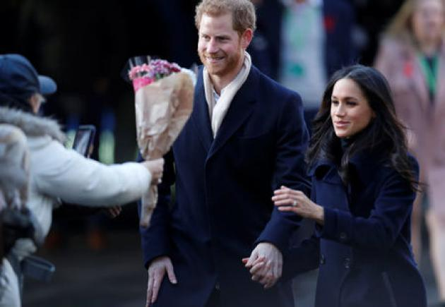 UK's Prince Harry and fiancee Markle take their first official walkabout