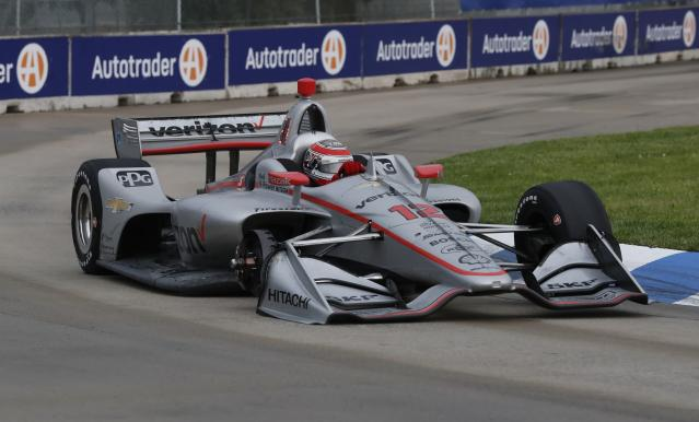 Will Power, of Australia, takes the eighth turn on three tires during the first race of the IndyCar Detroit Grand Prix auto racing doubleheader, Saturday, June 1, 2019, in Detroit. Power pulled out of the pit before the tire was fastened. (AP Photo/Carlos Osorio)