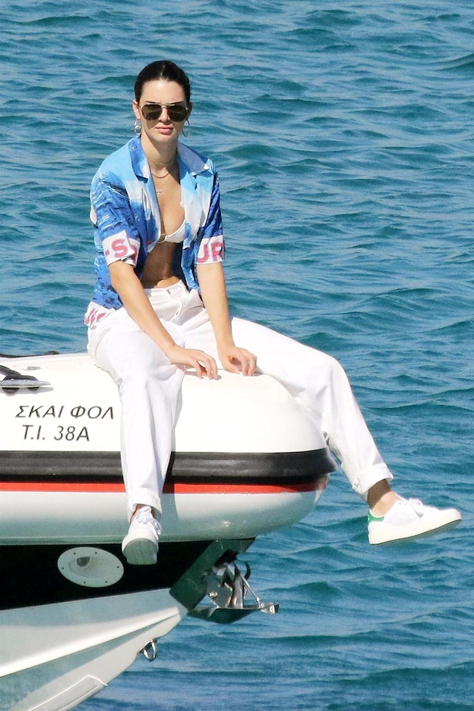 <p>Kendall's on a boat! The model flaunted her toned abs while cruising around Mykonos, Greece. We can't help but wonder… where's her travel partner and bestie, Bella Hadid? (Photo: Backgrid) </p>