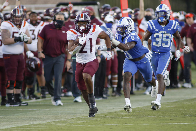 Virginia Tech running back Khalil Herbert (21), a Kansas transfer, has been running by people so far this season. (Nell Redmond/Pool Photo via AP)