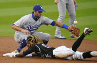 Colorado Rockies' Raimel Tapia slides safely into second base with a double as Los Angeles Dodgers shortstop Chris Taylor tries to catch the throw during the first inning of a baseball game Saturday, Sept. 19, 2020, in Denver. (AP Photo/David Zalubowski)