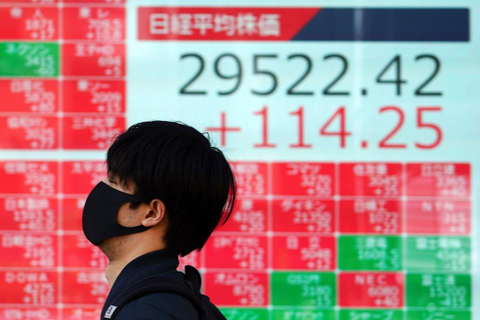 <p>Markets fell across Asia and in the US</p> (Copyright 2021 The Associated Press. All rights reserved)