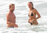<p>Simon Baker enjoys a swim with designer Laura May Gibbs in Byron Bay, Australia, following his split from wife Rebecca Rigg.</p>