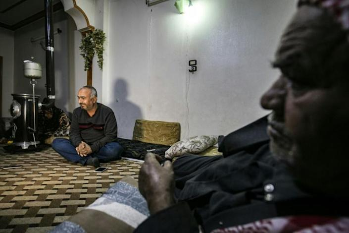 Syrian Kurdish merchant Mustafa al-Zaim, 44, says his home, a supermarket and several other stores were seized by Turkey-backed Syrian rebels (AFP Photo/Delil souleiman)