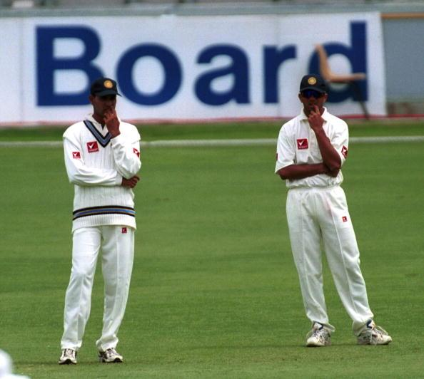 27 Nov 1999:  Rahul Dravid and Vangipurappu Laxman of India ponder the state of play against Queensland at the Gabba Cricket Ground in Brisbane,Australia. Mandatory Credit: Darren England/ALLSPORT