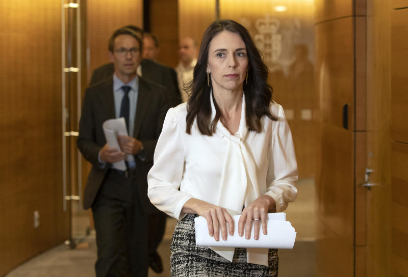 New Zealand's Prime Minister Jacinda Ardern, right, and Director-General of Health Dr Ashley Bloomfield arrive at the post-Cabinet media conference at Parliament.