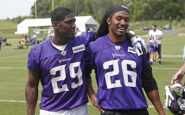 Minnesota Vikings cornerbacks Xavier Rhodes, left, and Trae Haynes leave the field after practice at the NFL football team's training camp in Eagan, Minn., Thursday, June 14, 2018. (AP Photo/Jim Mone)