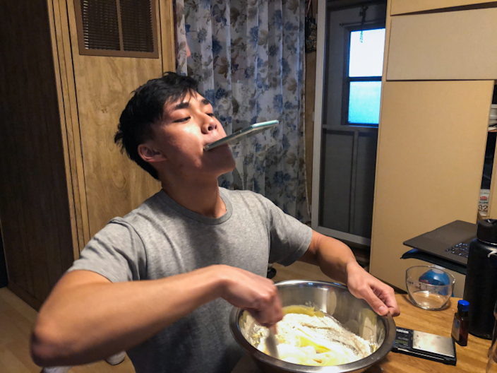 """Newton Nguyen recording a cooking video — anything for the bird's-eye-view shot. <span class=""""copyright"""">(Yvonne Nguyen / For The Times)</span>"""