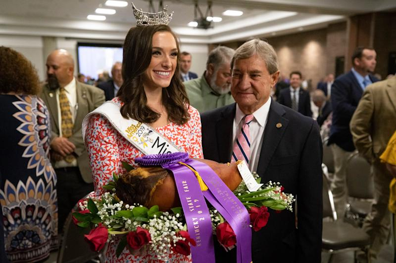Miss Kentucky 2019, Alex Francke, presents the Grand Champion Ham of the 2019 Kentucky State Fair, produced by Blake Penn, of Penn's Country Hams. It was auctioned at the 56th Annual Kentucky Country Ham Breakfast on Thursday. Central Bank won the bidding for the ham with a $1 million bid.
