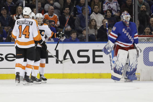 New York Rangers goaltender Henrik Lundqvist, right, reacts as the Philadelphia Flyers celebrates a goal by Travis Konecny, second from right, during the second period of the NHL hockey game, Sunday, March 1, 2020, in New York. (AP Photo/Seth Wenig)