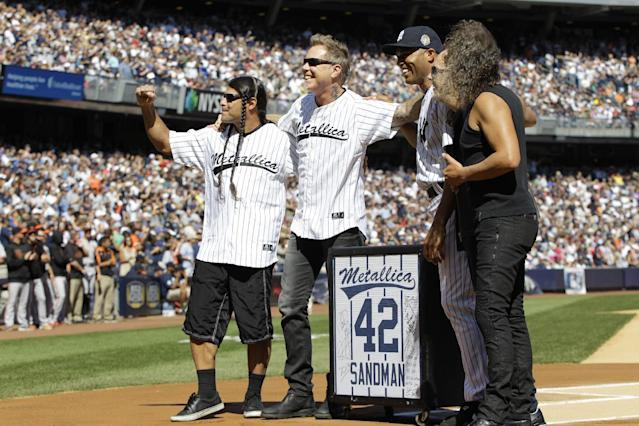 "New York Yankees relief pitcher Mariano Rivera, third from right, is joined by the members of the heavy metal band Metallica, from left, Robert Trujillo, James Hetfield, Lars Ulrich and Kirk Hammett as Rivera is honored in a pregame ceremony at Yankees Stadium before the Yankees baseball game against the San Francisco Giants, Sunday, Sept. 22, 2013, in New York. The 13-time All-Star closer is retiring at the end of this season. Rivera's signature song when he comes into the game is ""Enter Sandman"" by the band. (AP Photo/Kathy Willens)"