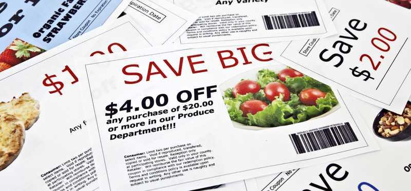 Coupons criss crossed on a surface.