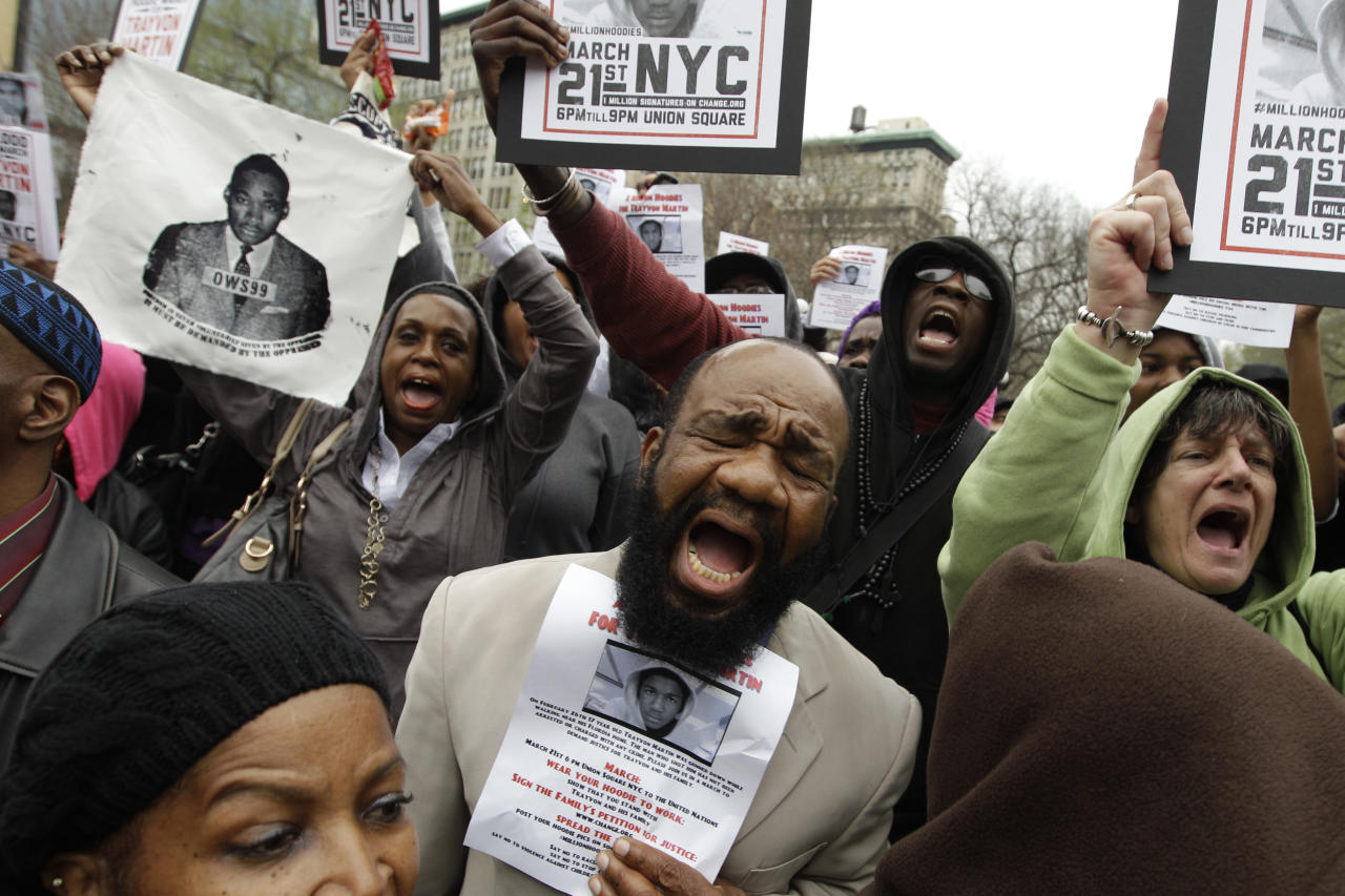 Demonstrators chant Trayvon Martin's name during the Million Hoodie March in Union Square Wednesday, March 21, 2012 in New York. The march was in memory of Martin, a black teenager shot to death by a Hispanic neighborhood watch captain in Florida. The teenager was unarmed and was wearing a hoodie. (AP Photo/Mary Altaffer)