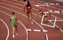 Bulgaria's Vania Stambolova (R) crashes into a hurdle as Lithuania's Egle Staisiunaite (L) and T'Erea Brown of the U.S. run in the women's 400m hurdles round 1 heat during the London 2012 Olympic Games at the Olympic Stadium August 5, 2012. REUTERS/David Gray (BRITAIN - Tags: OLYMPICS SPORT ATHLETICS TPX IMAGES OF THE DAY)