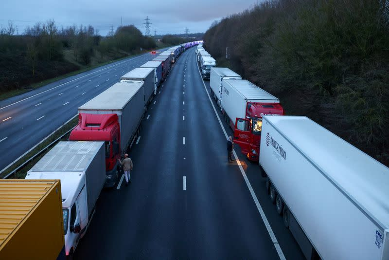 Lorries are seen parked on the M20 motorway near Ashford