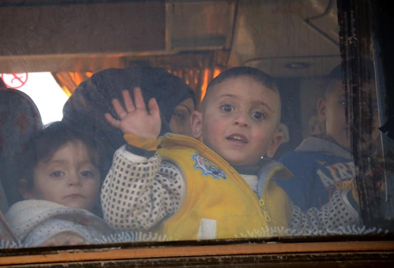The clashes in eastern Damascus took place as Syrian civilians were evacuated from Waer -- the last opposition-held district of Homs (AFP Photo/Nazeer al-Khatib)