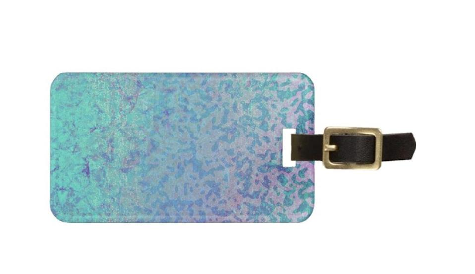 <p>Travelers will appreciare this <span>Zazzle Luggage Tag Glitter Star Dust</span> ($12).</p>