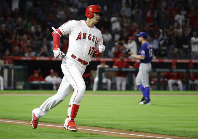 Los Angeles Angels' Shohei Ohtani, of Japan, rounds the bases after his home run against the Texas Rangers during the first inning of a baseball game in Anaheim, Calif., Monday, Sept. 24, 2018. (AP Photo/Chris Carlson)