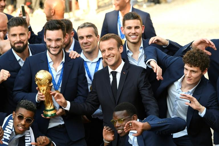President Emmanuel Macron celebrates with the victorious French side
