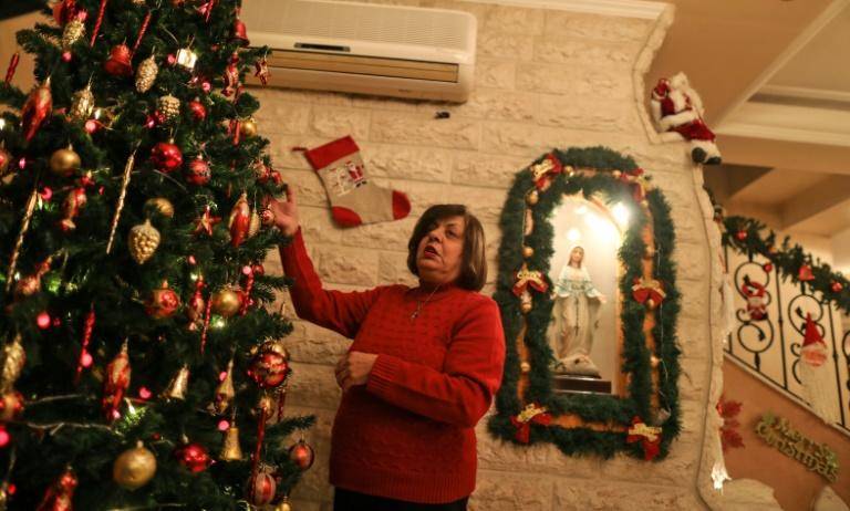 Hanadi Missak has decorated her home in Gaza for Christmas and says she will try to 'make joy' during the holiday despite not receiving a permit to travel to Bethlehem (AFP Photo/MAHMUD HAMS)