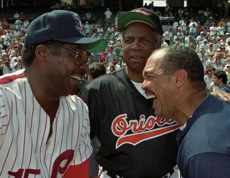 FILE PHOTO: Former New York Yankee great Reggie Jackson (R) shares a laugh with former Philadelphia Phillies Dick Allen (L) and former Baltimore Oriole Frank Robinson before an old timers game at Camden Yards July 12, 1993. Reuters/Mike Theiler/File Photo