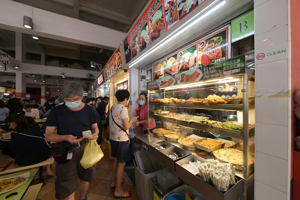 People buying food from the hawker stalls at Singapore's Albert Centre Market and Food Centre.