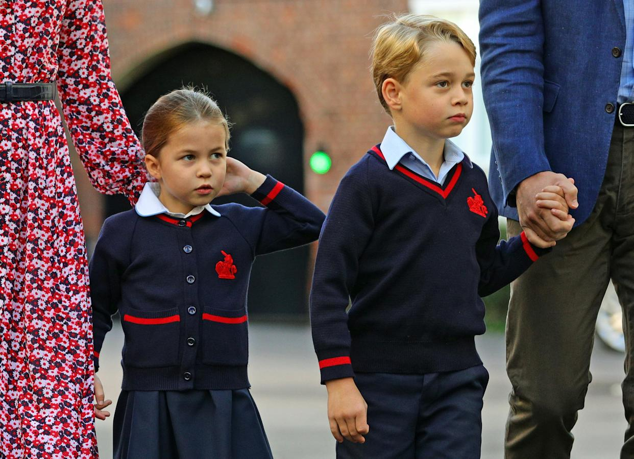 Britain's Princess Charlotte of Cambridge, with her brother, Britain's Prince George of Cambridge, arrives for her first day of school at Thomas's Battersea in London on September 5, 2019. (Photo by Aaron Chown / POOL / AFP)        (Photo credit should read AARON CHOWN/AFP via Getty Images)