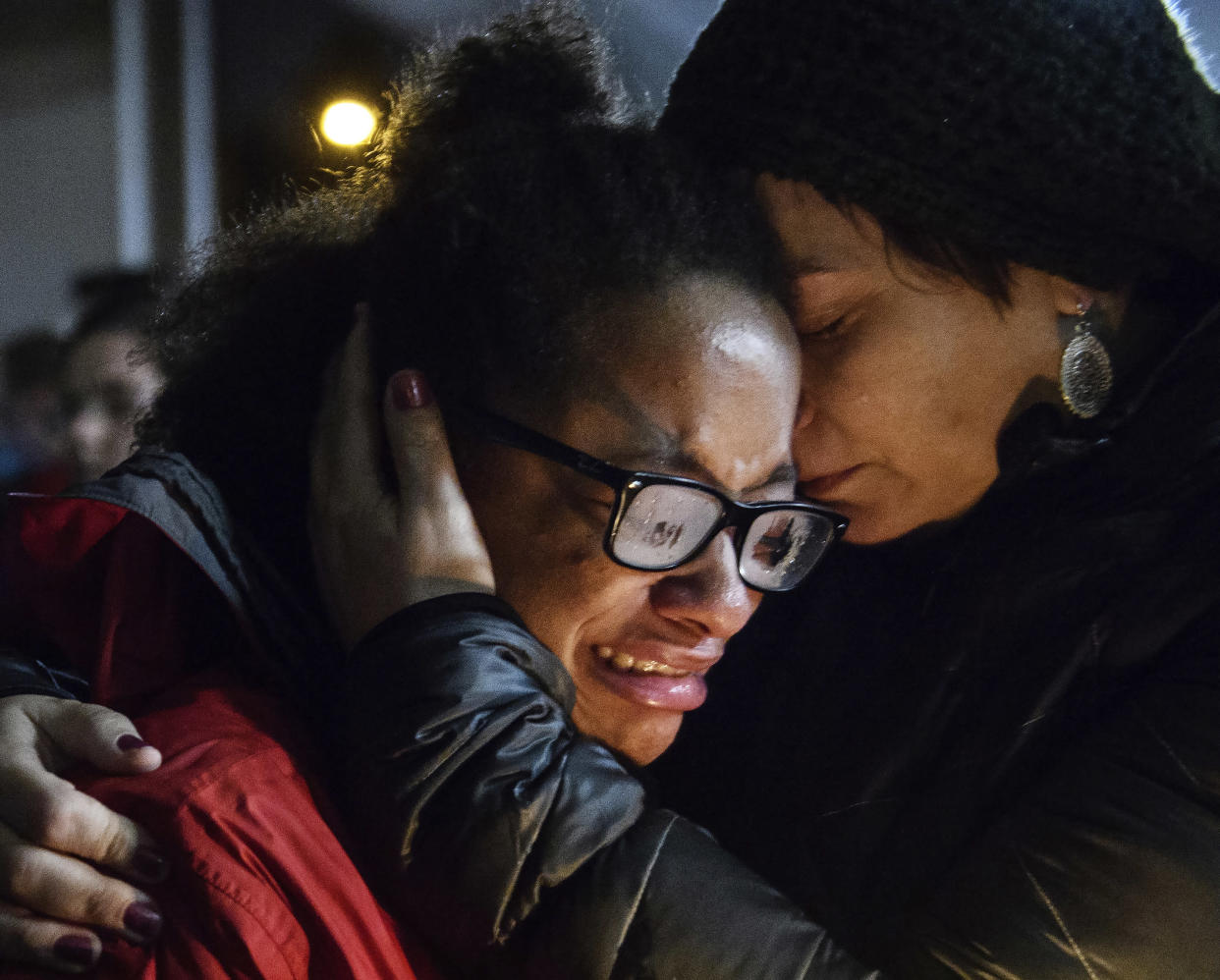 Isabel Kinnane Smith of Allderdice High School is comforted by math teacher Lesley Britton at a vigil blocks from where a shooter killed 11 people at the Tree of Life synagogue on Oct. 27, 2018. (Photo: Stephanie Strasburg/Pittsburgh Post-Gazette via AP)