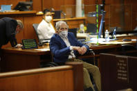 Robert Durst, center, appears in a courtroom with his attorney Dick DeGuerin, left, as Judge Mark E. Windham gives last instructions to jurors before attorneys begin opening statements in the trial of the real estate scion charged with murder of longtime friend Susan Berman, in Los Angeles County Superior Court, Tuesday, May 18, 2021, inInglewood, Calif. Durst's murder trial was delayed more than a year due to the Covid-19 pandemic. (Al Seib/Los Angeles Times via AP, Pool)