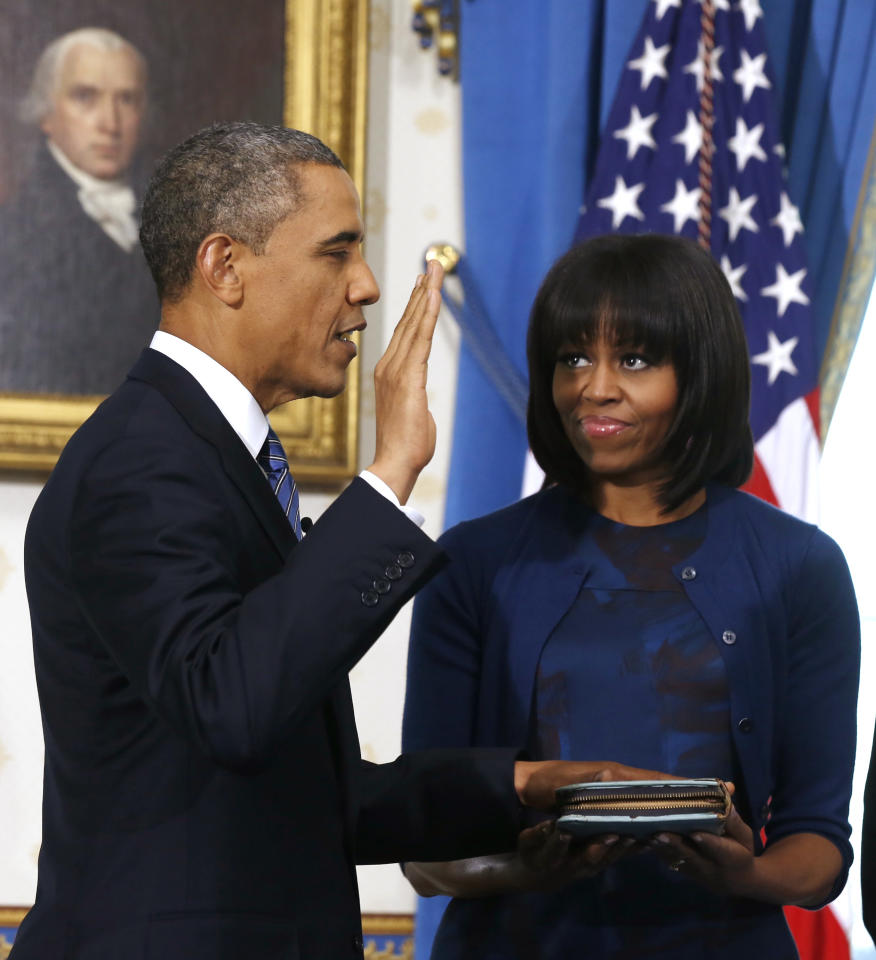 President Barack Obama is officially sworn-in by Chief Justice John Roberts in the Blue Room of the White House during the 57th Presidential Inauguration in Washington, Sunday Jan. 20, 2013, as first lady Michelle Obama, holds the Robinson Family Bible. (AP Photo/Larry Downing, Pool)