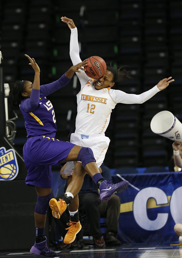 LSU forward Shanece McKinney (21) blocks a shot by Tennessee forward Bashaara Graves during the first half in an NCAA college basketball game in the quarterfinals of the Southeastern Conference women's tournament, Friday, March 7, 2014, in Duluth, Ga.(AP Photo/John Bazemore)