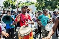 Protesters demonstrate in Port-au-Prince on October 30