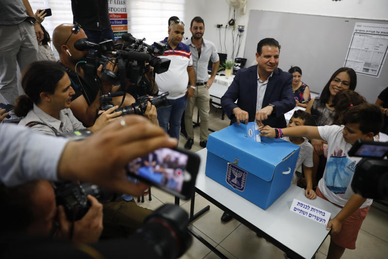 FILE - In this Tuesday, Sept. 17, 2019 file photo, Israeli Arab politician Ayman Odeh casts his vote in Haifa, Israel. Israel's Arab coalition appears poised to emerge as the main opposition bloc following Tuesday's vote. The historic first would grant a new platform to a long-marginalized minority and the only major political movement still pushing for peace with the Palestinians. (AP Photo/Ariel Schalit, File)