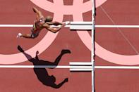<p>An overview shows Canada's Damian Warner as he competes in the men's decathlon 110m hurdles during the Tokyo 2020 Olympic Games at the Olympic Stadium in Tokyo on August 5, 2021. (Photo by Antonin THUILLIER / AFP)</p>