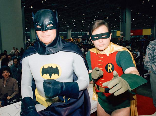 "<p>Actors Adam West, left, and Burt Ward, dressed as their characters (Zappp!) Batman and (Powww!) Robin, pause during an appearance Jan. 27, 1989 at the ""World of Wheels"" custom car show in Chicago. (Photo: Mark Elias/AP) </p>"