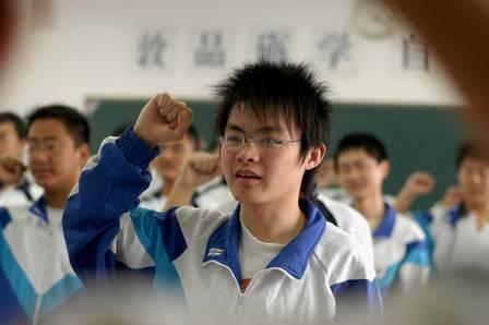 38329403_In this photo released by China's Xinhua News Agency Students take an oath not to cheat in.jpg