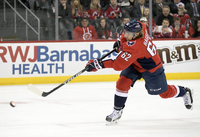 Washington Capitals left wing Carl Hagelin (62) takes a penalty shot against New Jersey Devils goaltender Mackenzie Blackwood during the first period of an NHL hockey game Friday, Dec. 20, 2019, in Newark, N.J. (AP Photo/Bill Kostroun)