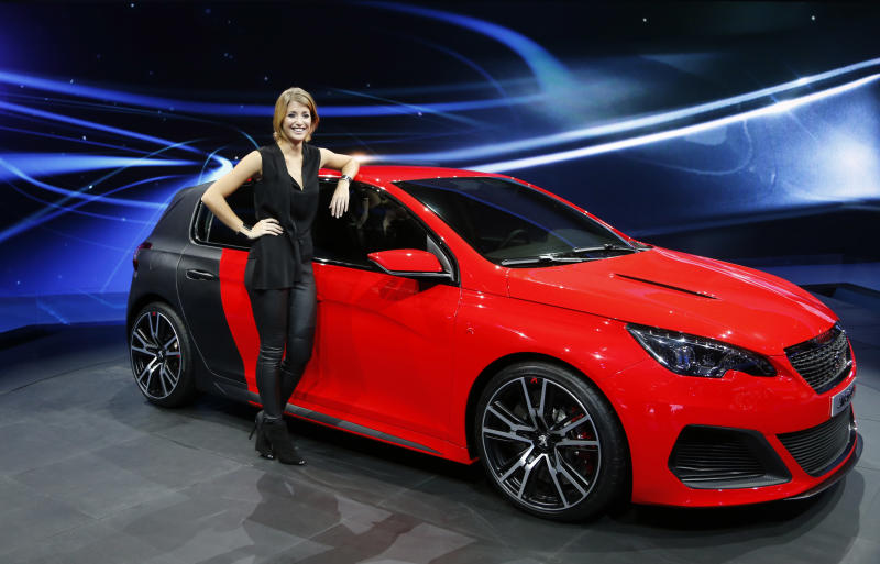 The new Peugeot 308 R is presented during the first press day of the 65th Frankfurt Auto Show in Frankfurt, Germany, Tuesday, Sept. 10, 2013. More than 1,000 exhibitors will show their products to the public from Sept. 12 through Sept.22, 2013. (AP Photo/Frank Augstein)