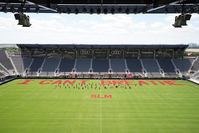 "D.C. United showed its support for global protests against police brutally and systemic racism by painting ""I Can't Breathe"" and ""BLM"" on the grass at Audi Field. (Via Twitter/@dcunited)"