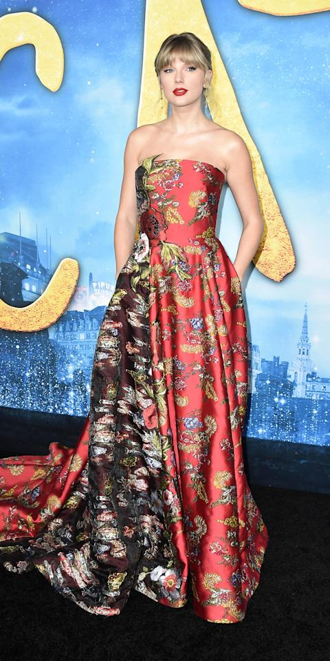 "<p>At the premiere of <em>Cats</em>, Taylor Swift wore an <a href=""https://www.pjatr.com/t/8-9035-131940-84605?sid=IS%2CTaylorSwift%2Canesta%2C%2CIMA%2C3507605%2C201912%2CI&url=https%3A%2F%2Fwww.oscardelarenta.com%2Fshop%2Fp%2Ffil-coupe-gown-19955"" target=""_blank"">Oscar de la Renta</a> gown ($17,990; <a href=""https://www.pjatr.com/t/8-9035-131940-84605?sid=IS%2CTaylorSwift%2Canesta%2C%2CIMA%2C3507605%2C201912%2CI&url=https%3A%2F%2Fwww.oscardelarenta.com%2Fshop%2Fp%2Ffil-coupe-gown-19955"" target=""_blank"">oscardelarenta.com</a>), <a href=""https://click.linksynergy.com/deeplink?id=93xLBvPhAeE&mid=25003&murl=https%3A%2F%2Fwww.neimanmarcus.com%2Fc%2Fdesigners-borgioni-cat72960732&u1=IS%2CTaylorSwift%2Canesta%2C%2CIMA%2C3507605%2C201912%2CI"" target=""_blank"">Borgioni</a> ring, Maxior earrings, and <a href=""https://click.linksynergy.com/deeplink?id=93xLBvPhAeE&mid=42352&murl=https%3A%2F%2Fwww.shopbop.com%2Fchloe-gosselin%2Fbr%2Fv%3D1%2F58028.htm&u1=IS%2CTaylorSwift%2Canesta%2C%2CIMA%2C3507605%2C201912%2CI"" target=""_blank"">Chloe Gosselin</a> sandals.</p>"