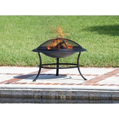 <p>Because of its compact size, this <span>Tokia Round Wooden Black Fire Pit</span> ($64) is easy to heat up.</p>
