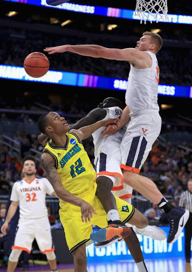 <p>Denzel Ingram #10 of the North Carolina-Wilmington Seahawks is blocked by Jack Salt #33 of the Virginia Cavaliers during the first round of the 2017 NCAA Men's Basketball Tournament at Amway Center on March 16, 2017 in Orlando, Florida. (Photo by Mike Ehrmann/Getty Images) </p>