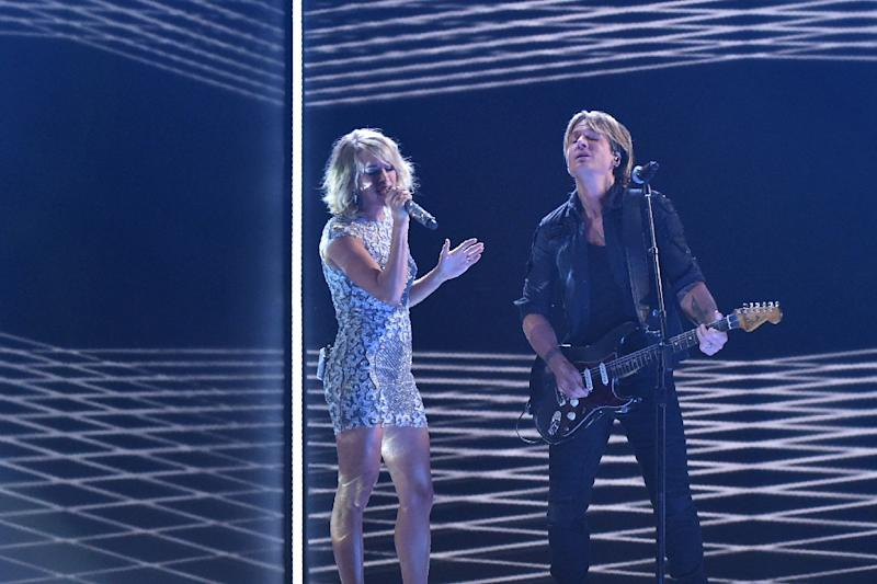 Keith Urban (R), pictured at the Grammies on February 12, 2017, says he approached Pitbull about collaborating after hearing the Cuban-American rapper on the radio