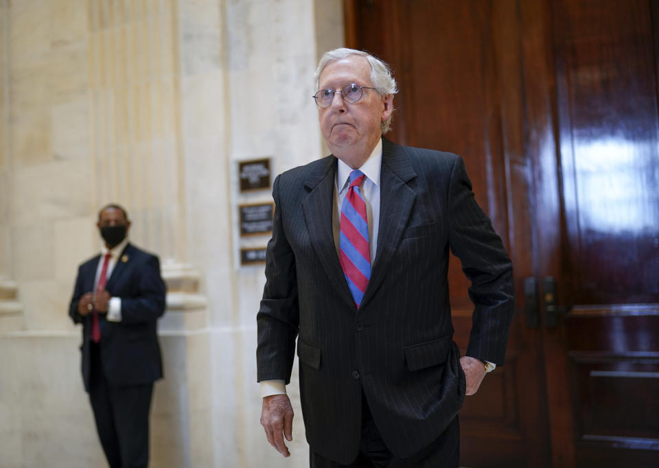 Senate Minority Leader Mitch McConnell, R-Ky., returns to the Senate chamber for a vote after attending a bipartisan barbecue luncheon, at the Capitol in Washington, Thursday, Sept. 23, 2021. (AP Photo/J. Scott Applewhite)