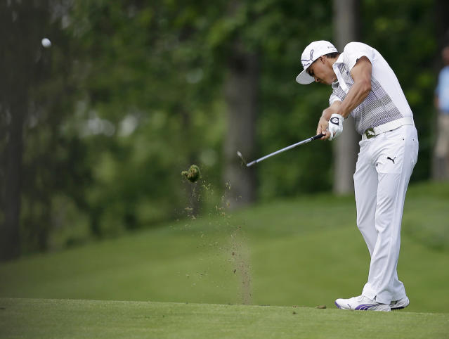 Rickie Fowlerhits from the ninth fairway during the first round of the Memorial golf tournament Thursday, May 29, 2014, in Dublin, Ohio. (AP Photo/Darron Cummings)