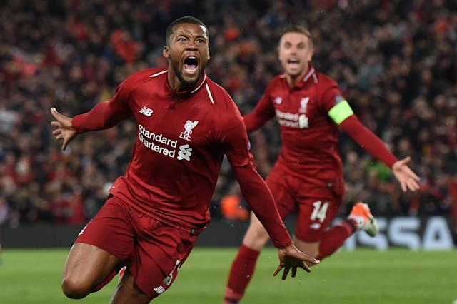 Liverpool's Dutch midfielder Georginio Wijnaldum celebrates after scoring their third goal during the UEFA Champions league semi-final second leg football match between Liverpool and Barcelona at Anfield in Liverpool, north west England on May 7, 2019. (Photo by Paul Ellis/AFP/Getty Images)
