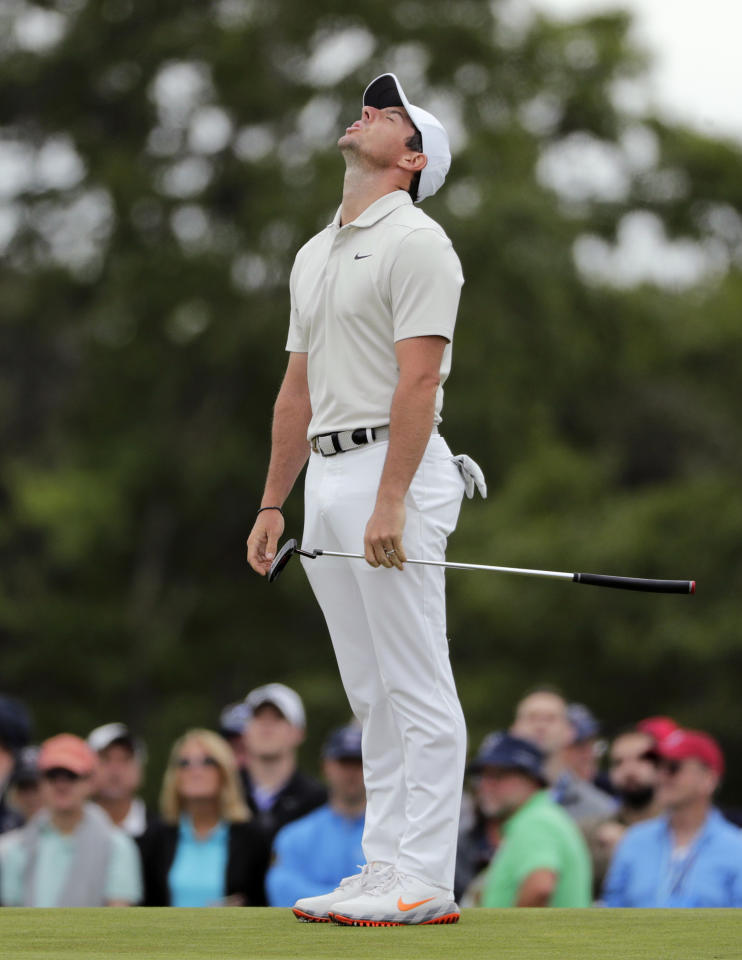 Rory McIlroy of Northern Ireland reacts after a putt on the seventh green during the second round of the U.S. Open Golf Championship, Friday, June 15, 2018, in Southampton, N.Y. (AP Photo/Frank Franklin II)